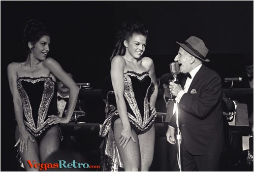 Photo of Jimmy Durante & 2 Showgirls on Las Vegas stage