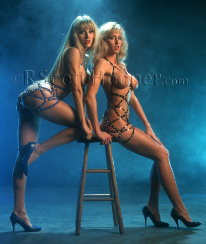 Photo of nude 2 girls with leather straps on