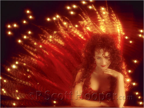 Photo of Danielle Rossetti-Busa in her red Stardust Hotel showgirl costume