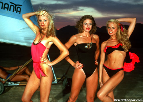 Photo of 3 girls in swimwear at dusk on the desert