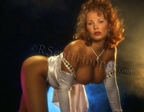 Image of stripper Heather Bankx in white satin