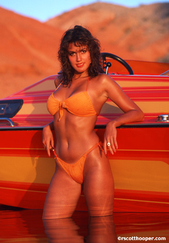Photo of woman in bikini with speedboat
