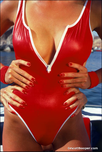 Four hands on sexy red swimsuit