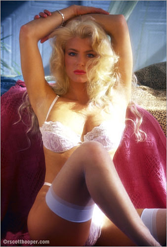 Photograph of a blonde in white bra and panties