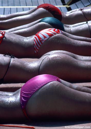 Photo of several butts in swimsuits sunbathing