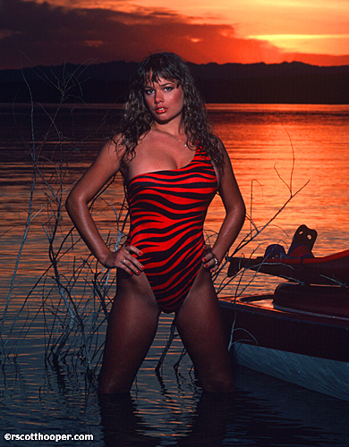 Photo of girl in red swimsuit at sunset