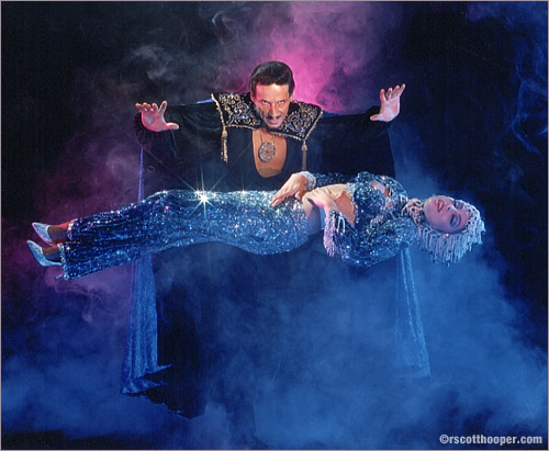 Photo of Barclay Shaw levitating a showgirl