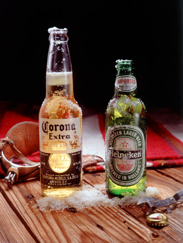 Image of Corona and Heineken beer bottles