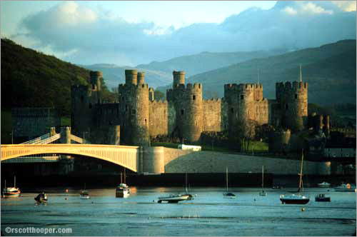 Photo of Conwy Castle in Wales at sunset