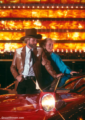 Photo of cowboy and woman in front of Dunes Hotel, Las Vegas