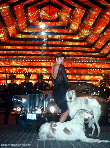 Photo of woman with rolls royce and dogs in front of Dunes Hotel in Las Vegas