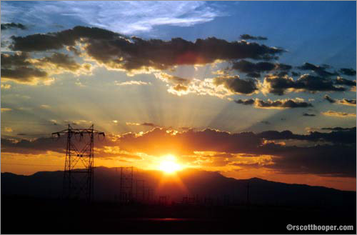 Photo of sunset with electrical towers