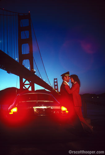 Photo of couple by the Golden Gate bridge at sunset