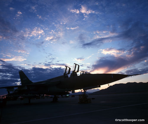 Photo of military jet on runway at dawn