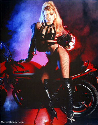 Photo of Melinda The First Lady of Magic and motorcycle