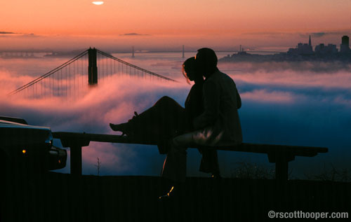 Couple overlooking the Golden Gate Bridge and clouds