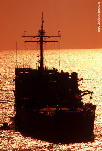 Image of large ship in the ocean at sunset