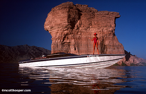 Photo of woman in swimsuit on boat with cowboy hat and lasso